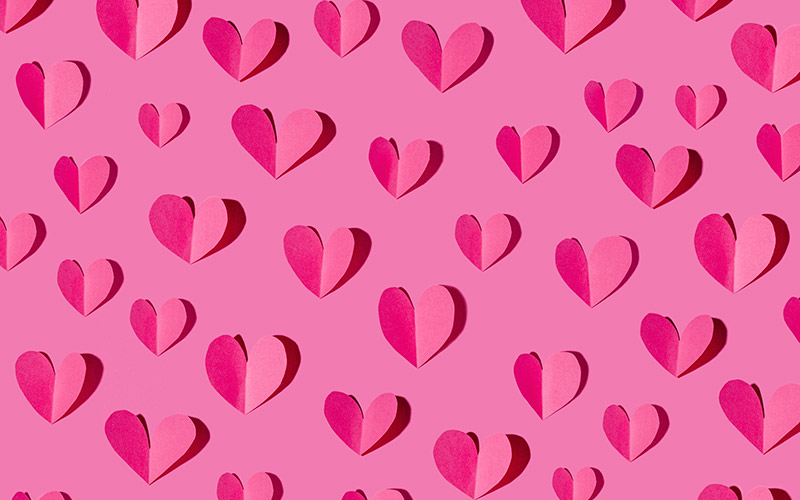 pink background full of dark pink paper hearts