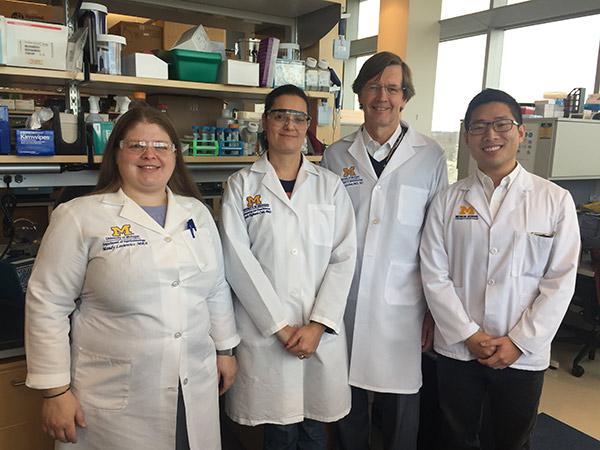 Four people in lab coats